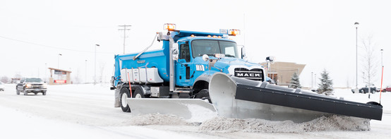 county snow plow on road