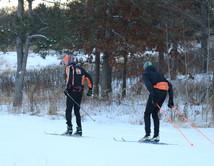 two people cross county skiiing