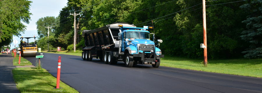 Public works truck paving road