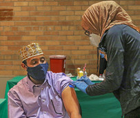 Resident getting vaccine