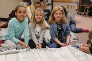 Andersen students tying blankets