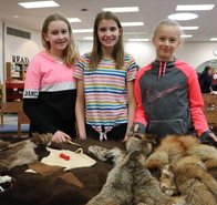 students with Native American animal hides