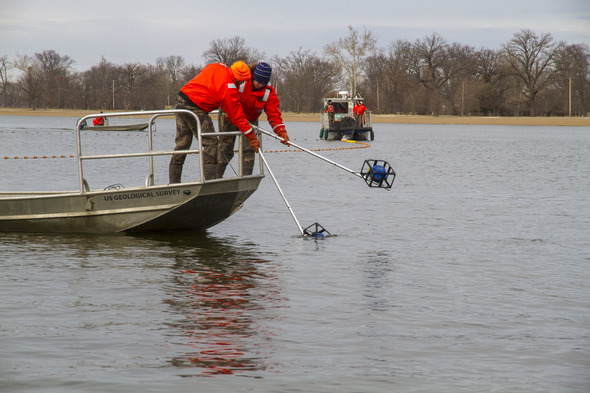 Biologists employing underwater speakers to drive the           Asian carp
