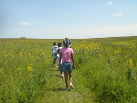 Kids walking through the prairie at Prairie State Park
