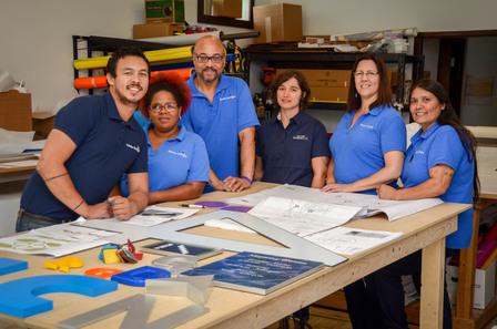 Photo of Adobe DeSigns staff
