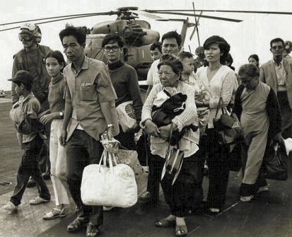 Image of Vietnamese refugees on a U.S. aircraft carrier