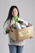 Image of woman holding box of hazardous household items