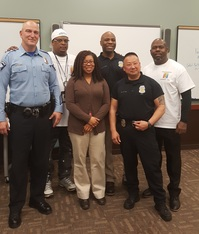 Image of Ayianna at a police community relations series she organized