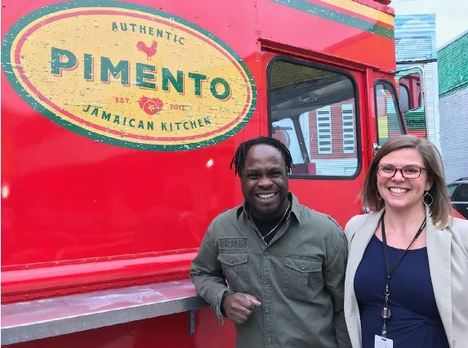 photo of Pimento kitchen owner Tomme in front of food truck
