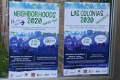 Neighborhoods 2020 Posters on a Glass Door
