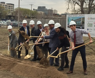 photo of leaders breaking ground at Great River Landing