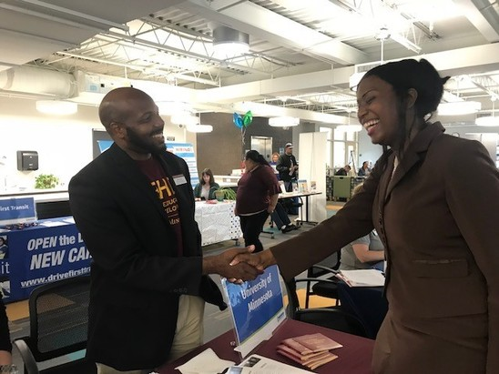 photo of people shaking hands at the Northside Job Fair