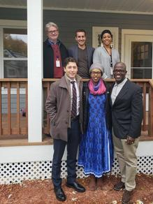 Noor Development CEO and City staff outside a developed home photo