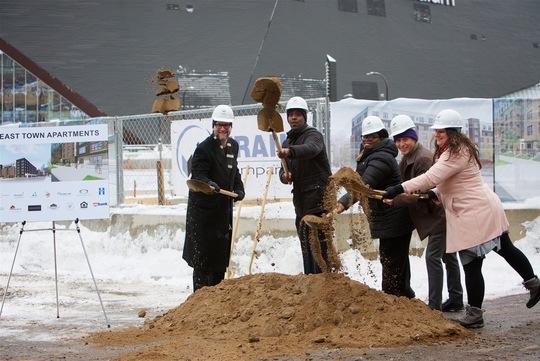 photo of community leaders breaking ground to new development