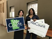 Michelle Rivero and Alberder Gillespie holding We Count signs at 2020 Census kickoff celebration