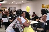 two women hug at Da Hive Co-working Space
