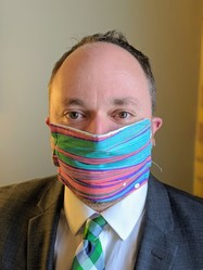 Council Member Fletcher wearing a cloth mask