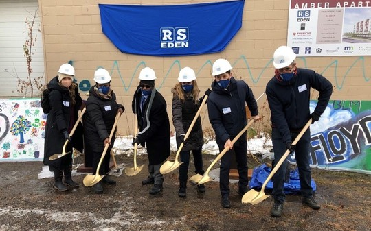 City leaders with shovels breaking ground outside