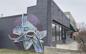 image of a catfish painted on side of building