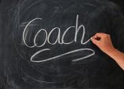 """""""Coach"""" written on a chalk board"""