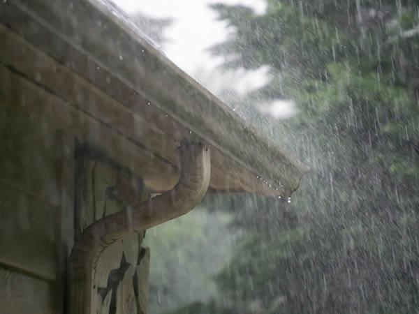 Rain falling off roof