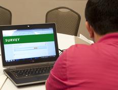 Man Taking an Online Survey