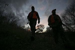 Pair of firearm deer hunters