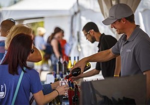 Vendors pouring wine samples