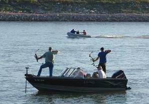 Men bowfishing