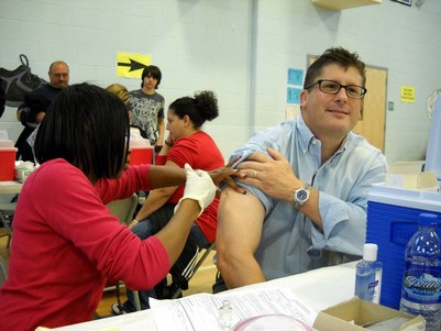 Flu shot being administered by a public health nurse