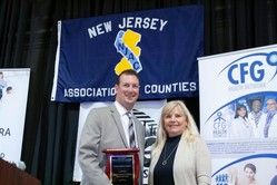 MCHD Christopher Merkel receives NJAC award. He is pictured with County Administrator Teri O'Connor.