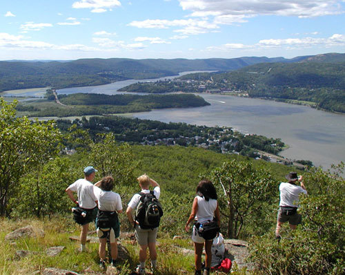 A group of hikers on a clearing overlooking the Hudson River