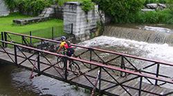 Person on biking riding over a bridge