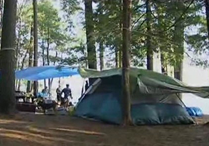 People with a tent at a campground.