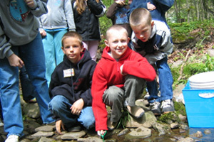 Students helping stock trout