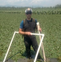 Russell Barbera measures tidal marsh migration.
