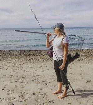 Woman fishing on beach