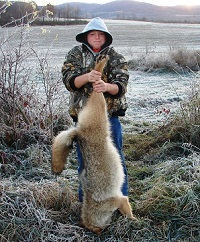 Boy poses with coyote he has hunted