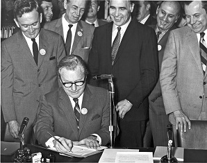 Nelson Rockefeller signing legislation