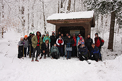Group of hikers visiting a lean to on a First Day Hike