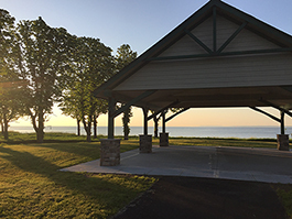 A sunset underneath the pavillion at Mt. Loretto Unique Area on the shores of Staten Island