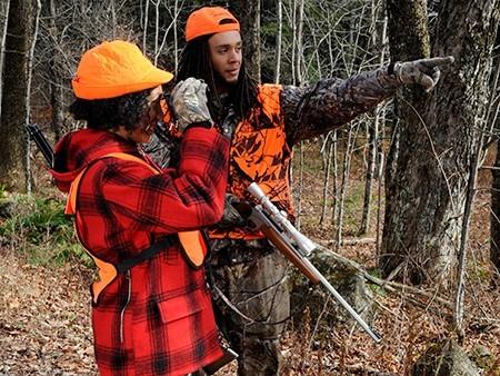 two hunters in blaze orange