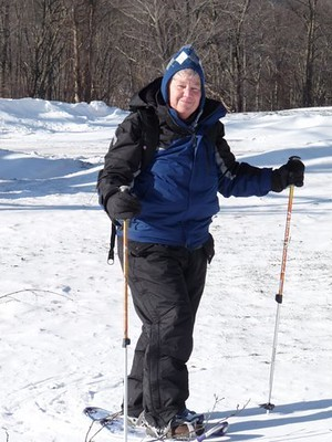 Woman snowshoeing at BOW in the SNOW workshop