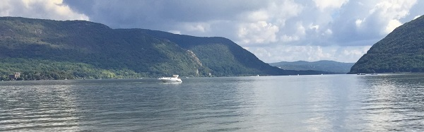 View of the Hudson River surrounded by the mountains of the Hudson Highlands.