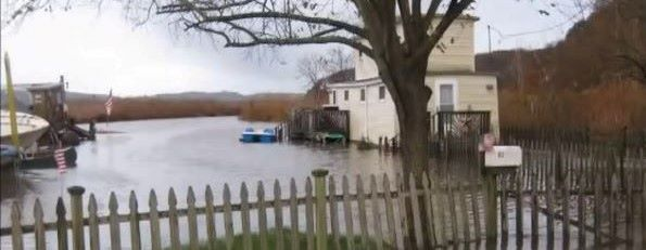 A house is surrounded by water during a flood.
