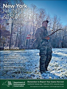 Cover of the 2021-2022 hunting and trapping regulations guide depicting a man with a longbow in the snow