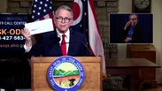 DeWine with dividend check