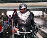 Cyclist biking in winter