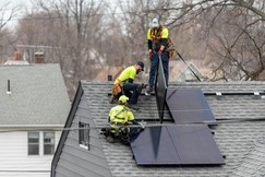 Solar installers installing roof top solar panel