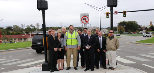 Representatives from Perrysburg, DGL, and ODOT with the America's Transportation Award
